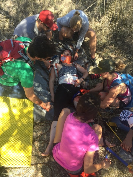 Wilderness medicine students with simulated injured patient